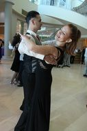 beautiful couple is dancing tango
