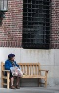 an old woman resting on a bench