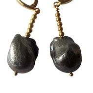 earrings with dark stones