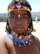 African girl is decorated with beads