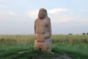 stone woman on green grass in Kursk