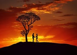 couple in love stands on a hill at sunset