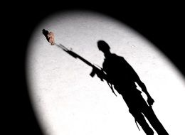 shadow of a female soldier with a gun