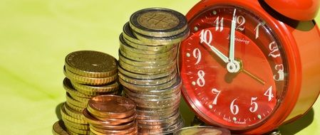 red alarm clock and euro coins