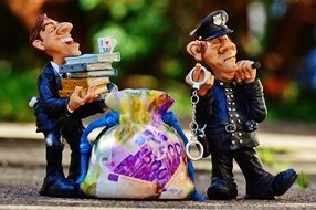 funny figures of tax consultant and policeman
