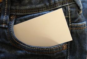 business card in jeans pocket