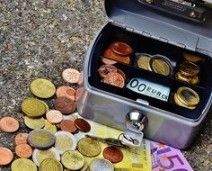 cashbox with euro coins and banknotes