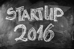 Start-up 2016 sign on a blackboard