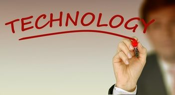 "businessman and red lettering ""technology"""