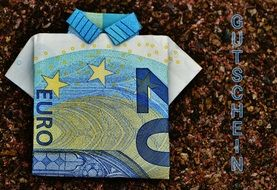 folded euro banknote on brown background