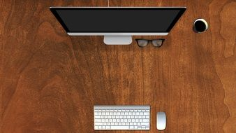 computer monitor, mouse, Keyboard and glasses on wooden table