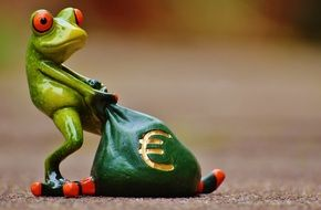 frog figure with a bag of money