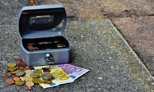 euro coins and banknotes in cash box
