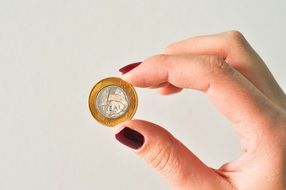 Hand holding brazilian currency coin