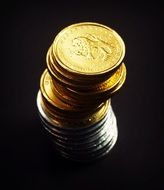 tower of silver and gold coins