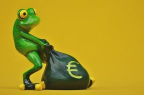 ceramic frog with money bag