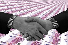 shaking hands on a euro banknotes background