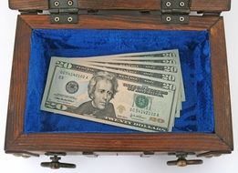 dollars in the wooden box