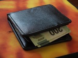 banknotes in a leather wallet