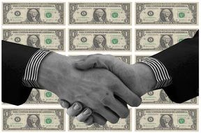 shaking hands on the dollars background