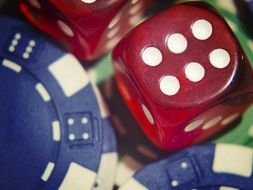 red dice lie on casino chips