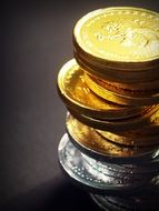 tower of yellow and gray coins