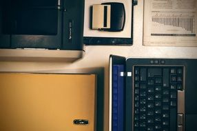 Laptop,Printer and Office Folder on table
