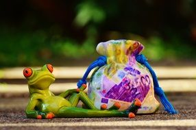 ceramic frog and money bag