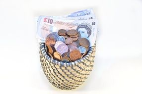 coins and banknotes in a basket