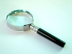 magnifying Glass on green background