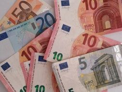 Euro banknotes of different denominations on the table