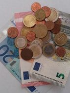 Euro banknotes and metal coins