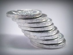 tower of coins on a white surface