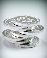 silver tower of coins