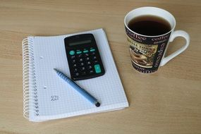 Calculator, Pen and coffee