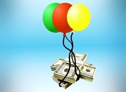 dollars are tied to balloons