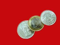 coins of swiss francs on a red background