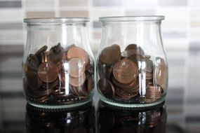 coins in two Glass jars