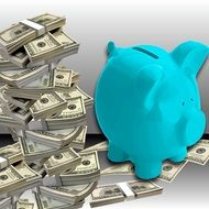 blue piggy bank on dollar bills
