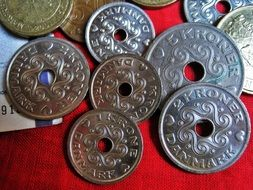 Danish coins on a red background