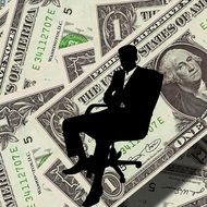 silhouette of a businessman on the dollar background