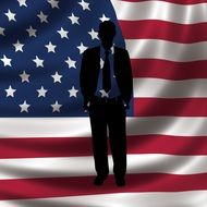 silhouette of a man on the background of the american flag