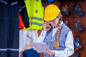 girl in a yellow helmet for industrial safety