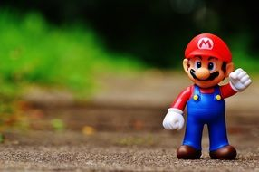super mario figurine on the track