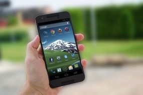 smartphone with the image of the mountains on the screen saver