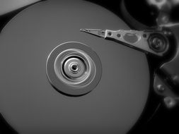 Black and white photo of the hard drive of computer
