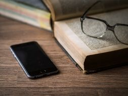 old book and smartphone