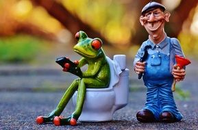 plumber and frog on the toilet