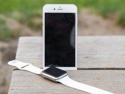 stylish white Iphone and Iwatch