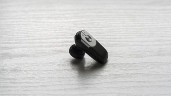 black Handsfree Earphone at grey surface